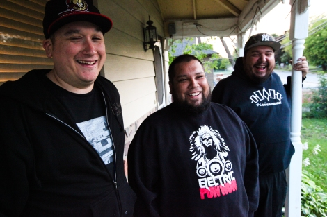 Members of A Tribe Called Red on DJ Shub (Dan General)'s porch near Ottawa: from left, Ian Campeau, Bear Thomas, Dan General