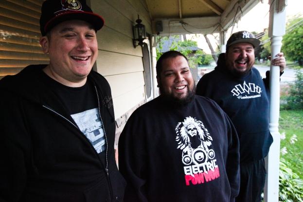 Members of A Tribe Called Red on DJ Shub (Dan General)'s porch near Ottawa: from left, Ian Campeau, Bear Thomas, Dan General