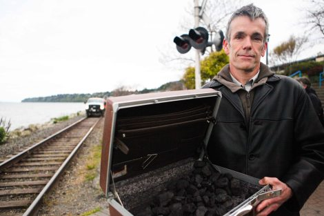 Kevin Washbrook protesting coal transport in Whiterock, BC in a photograph for the Vancouver Observer by David P. Ball