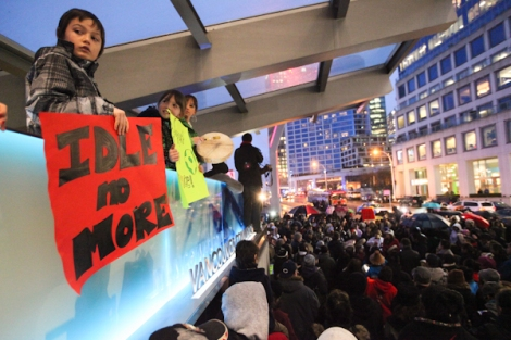 Idle No More participants in Vancouver, B.C. rally outside downtown's Canada Place, as local organizers prepare for another event at the U.S. border on January 5.