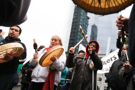 Indigenous protesters drummed and sang outside the Enbridge Northern Gateway hearings, which faced more than 1,000 protesters when it began hearings in Vancouver, British Columbia, on January 14, 2013. Photo by David P. Ball
