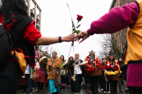 Carrying red roses for the dead and yellow for the missing, thousands marched through Vancouver's Downtown Eastside to end violence against aboriginal women in Canada. Photo by David P. Ball