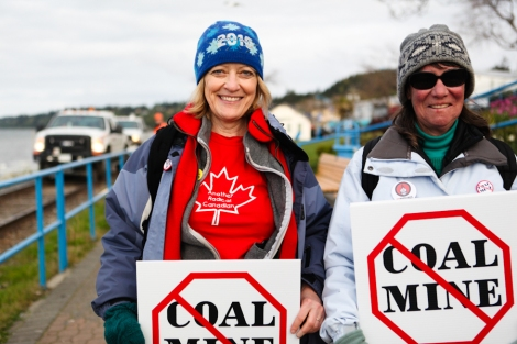 Vancouver Island residents Lynne Wheeler and Dawn Christian join the blockade of BNSF coal trains heading north from the US at White Rock last May. Photo: David P. Ball
