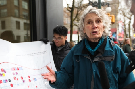 Jean Swanson, with the Carnegie Community Action Project (CCAP), explains a colour-coded map illustrating rent increases in the Downtown Eastside. Photo by David P. Ball