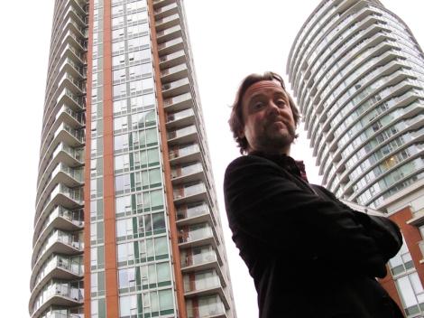 Matt Toner, in his False Creek apartment tower courtyard. Photo by David P. Ball