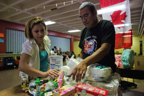 """We want to see a policy of zero barriers for migrants,"" says nurse Byron Cruz (right), with support worker Araceli Orozco (left) while preparing baby supplies for migrant women. Photo by David P. Ball"