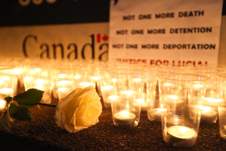 Migrant advocates hold a candlelight vigil outside the Canada Border Services Agency's Vancouver offices. Photo by David P. Ball