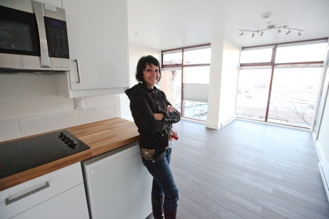 Atira's intergeneration mentorship program coordinator Jennifer Kleinsteuber inside a soon-to-be-occupied suite. Misgivings about housing women in 'crates' evaporated amid 'amazement at how beautiful these looked on the outside and on the inside,' she says. Photo by David P. Ball