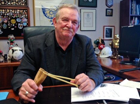 In his Burnaby City Hall office, Mayor Derek Corrigan shows off a slingshot gifted to him by a constituent, a symbol of his Kinder Morgan stance. Photo by David P. Ball