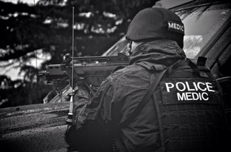 Cst. John Smith, shown here in tactical gear during a training exercise, lives with post-traumatic stress disorder. Photo submitted.