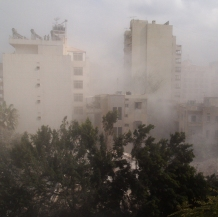 Smoke rises from rubble in west Beirut. Photo David P. Ball 2006